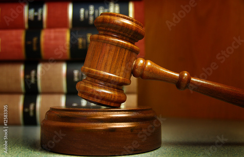 Judges gavel and law books stacked behind