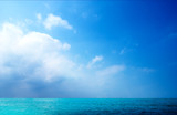ocean and white clouds poster