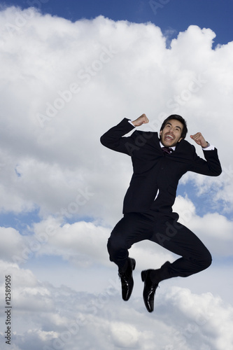 A businessman leaping in the air