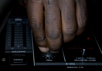 Hand of the dj on the mixer