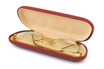 Retro golden glasses in case