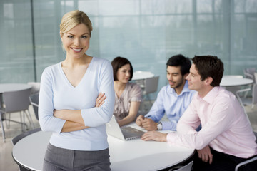 A female business project leader at team meeting