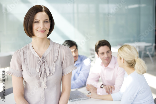 A female business project leader at a team meeting
