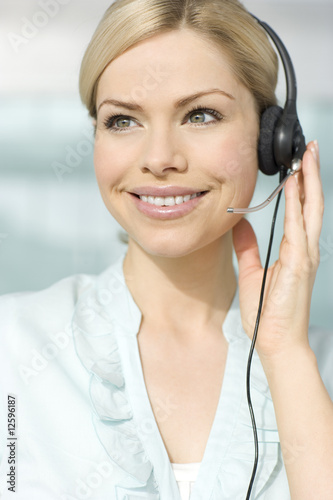 A woman wearing a headset