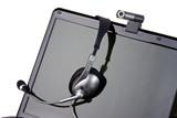 laptop with headset and webcam poster