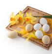 Easter eggs on a tray with flowers