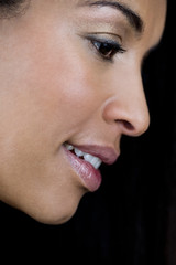 A portrait of an attractive young black woman, side view