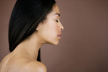 A portrait of a young black woman, side view