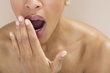 Close-up of a woman yawning
