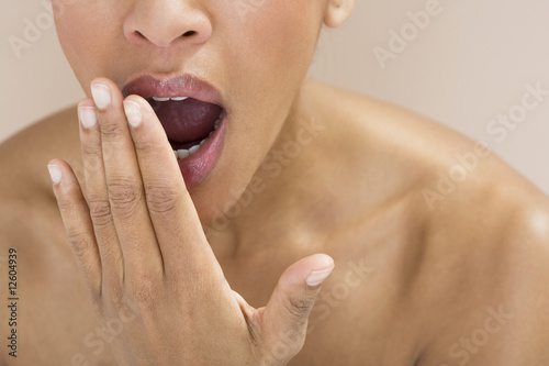 Close-up of a woman yawning