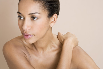 A young woman massaging her shoulder