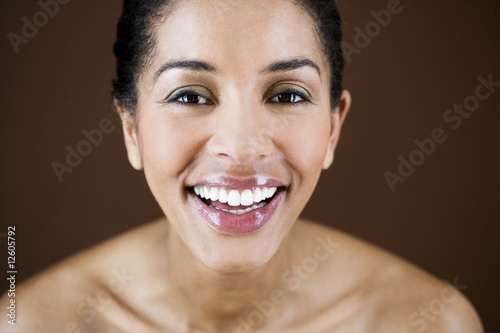 Close-up portrait of young woman, smiling