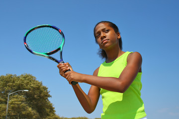 Teenage female tennis player