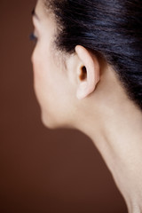 Close-up of womans head showing cheek, ear and neck