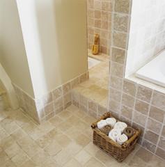 Towels in Basket on Tiled Floor