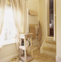 Beige Bathroom with Steps to Bedroom