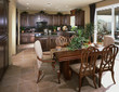 Traditional Kitchen and Dining Area with Dark Wood Furnishings
