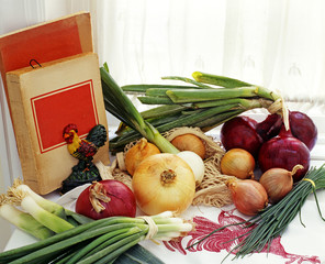 Fresh Produce on Countertop by Old Cookbooks