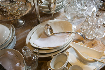 Collection of Dishes and Glassware on Table