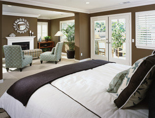 Contemporary Master Bedroom with Sitting Area by Fireplace