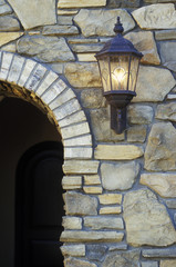 Outdoor Light by Arched Doorway of House