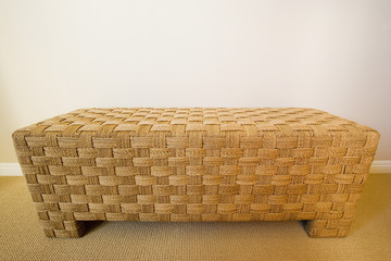 Tan Woven Bench on Carpet