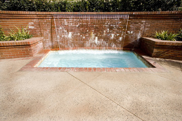 Water Wall Pouring into Jacuzzi