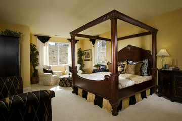 Master Bedroom with Large Wooden Bed