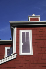 Window and Roofline on Red Shingled House