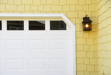 Detail of Garage Door on Yellow Shingled House