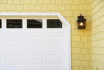 Detail of Garage Door on Yellow Shingled House