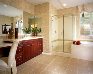 Master Bathroom with Tilework and Glass Shower Stall