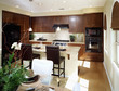 Contemporary Kitchen with Island and Glass Dining Table