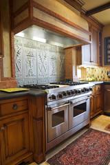 Oven with Ornate Metal Backsplash
