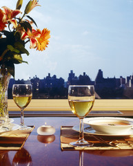Dinner Settings on Table with View of Skyline