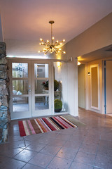 Front Doors Set in Glass Wall of Foyer