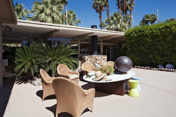 Wicker Armchairs by Table on Patio of Modern Home