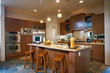 Contemporary Kitchen with Wood Cabinets and Marble Countertops
