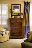 Wooden Chest of Drawers between Windows