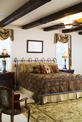 Traditional Furnishings in Bedroom with Beamed Ceiling