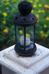 Candle in Lantern on Top of Post