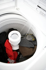White washing machine filling with water