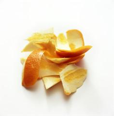 Orange peels kept on a white table