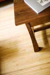 Wooden coffee table on beadboard mat