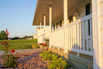 Rock planter next to white porch