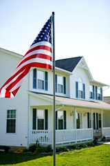 American flag outside rural multi-level home