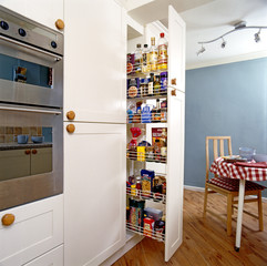 Slide Out Shelves Providing Pantry Storage
