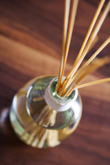 Home fragrance oil in a jar with wicking sticks used to disperse it