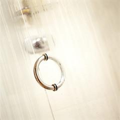 Dew formed on the glass door of a bathroom