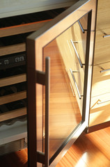 A high angle view of an opened door of a cabinet